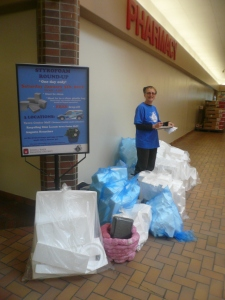Suzanne volunteers for the Styrofoam Round-Up inside the mall