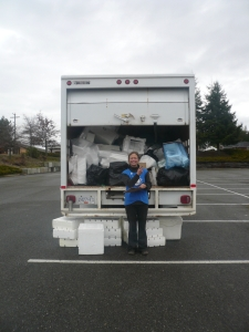 Coco collects styrofoam outside the Town Center Mall